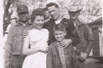 Ivan in his navy uniform with his wife Della Sue, nephew Clint, and brothers Joe, EC and Bob Chron